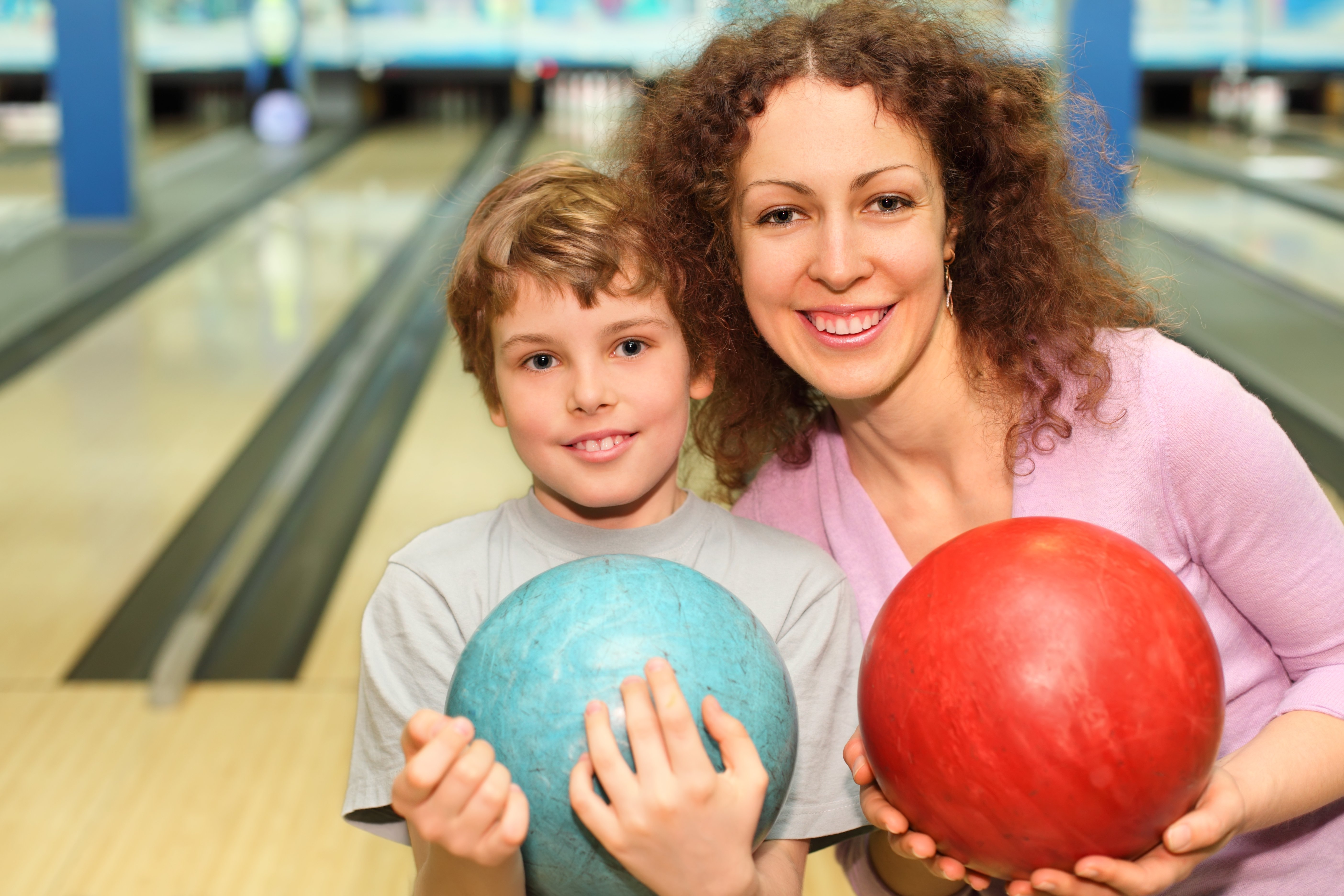Mother and son bowling