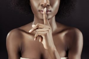 Woman and silence gesture